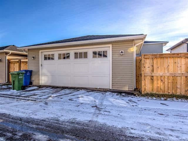 Artistique Homes Exterior Image - Garage